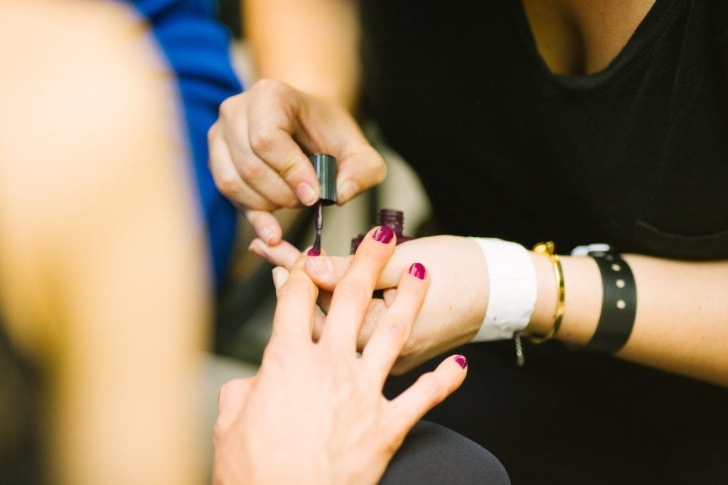 person receiving a manicure