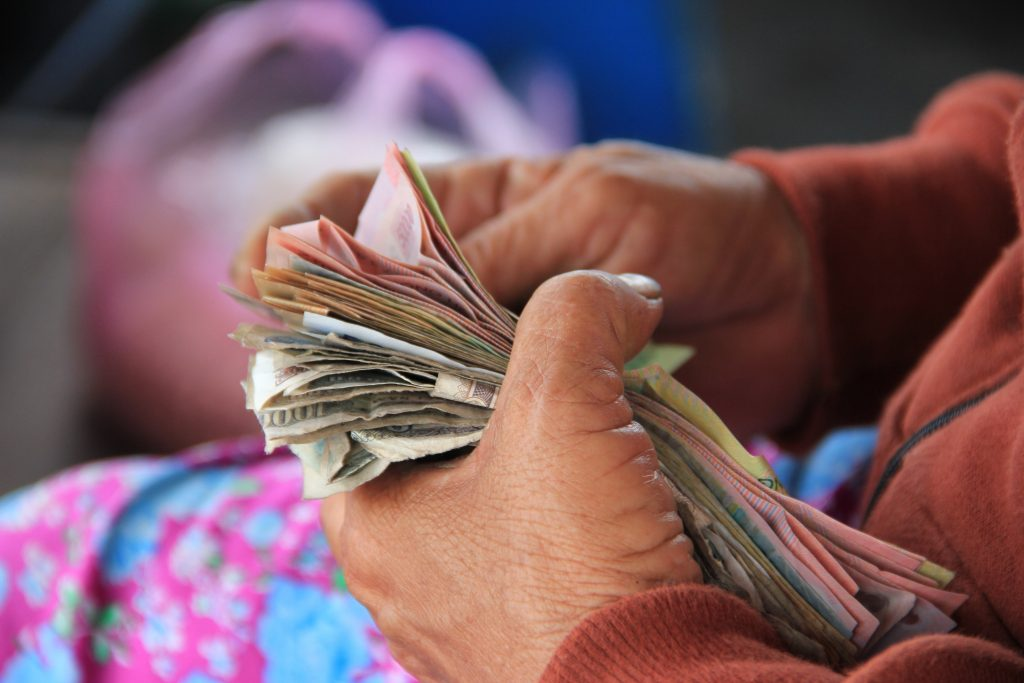 a picture of hands counting money