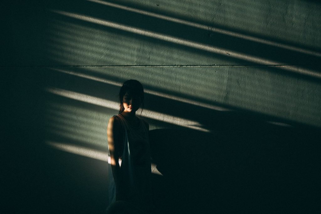 girl stood in the shadows