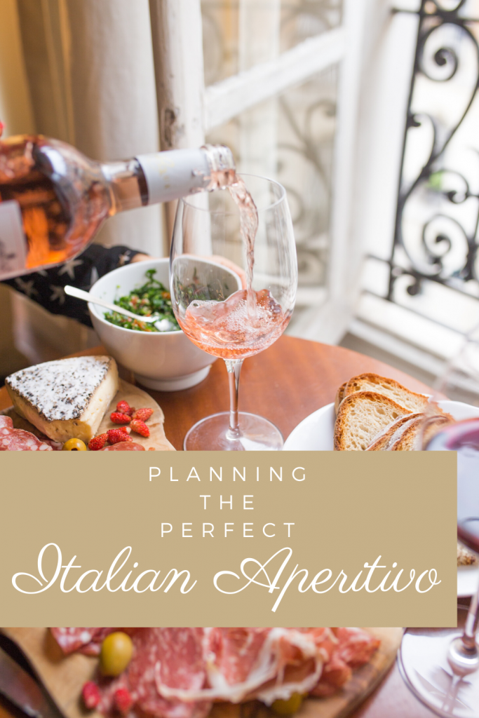 Italian Aperitivo - Everything You Need to Know. This article will not only cover the differences between an aperitivo and an apericena, but also the history of the aperitivo, the best aperitivo cocktails, foods, and how to create your very own aperitivo evening at home! #datenight #athomedatenight #aperitivo #italianaperitivo #apericena #romanticmeal #datenightideas